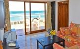 Salon view to sun-terrace and beachfront Apartment 310 Playa Dorada